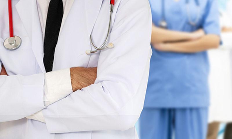 bigstock-doctor-working-in-hospital-wit-264433834